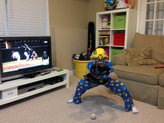 Kid D watching college baseball on a Saturday morning.